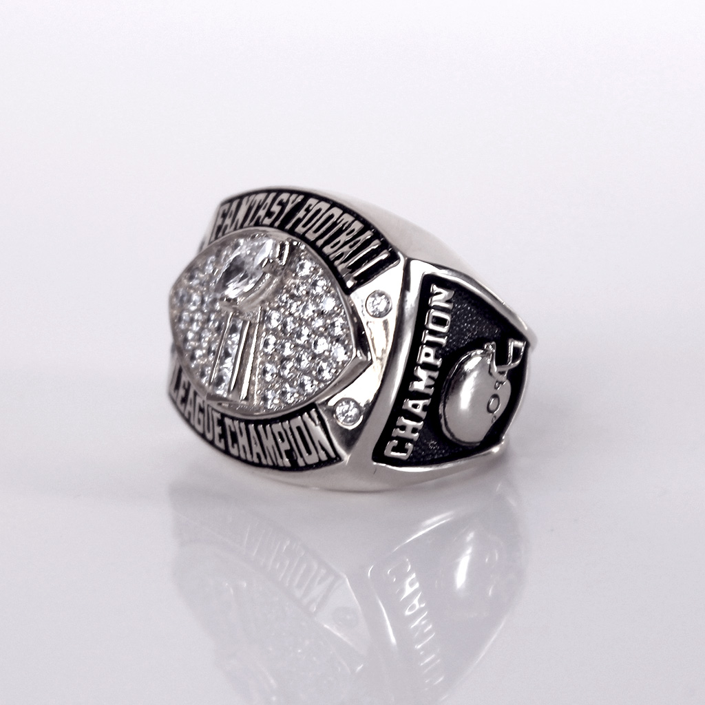 Fantasy Football Championship Ring trophy with CHAMPION written on the side.