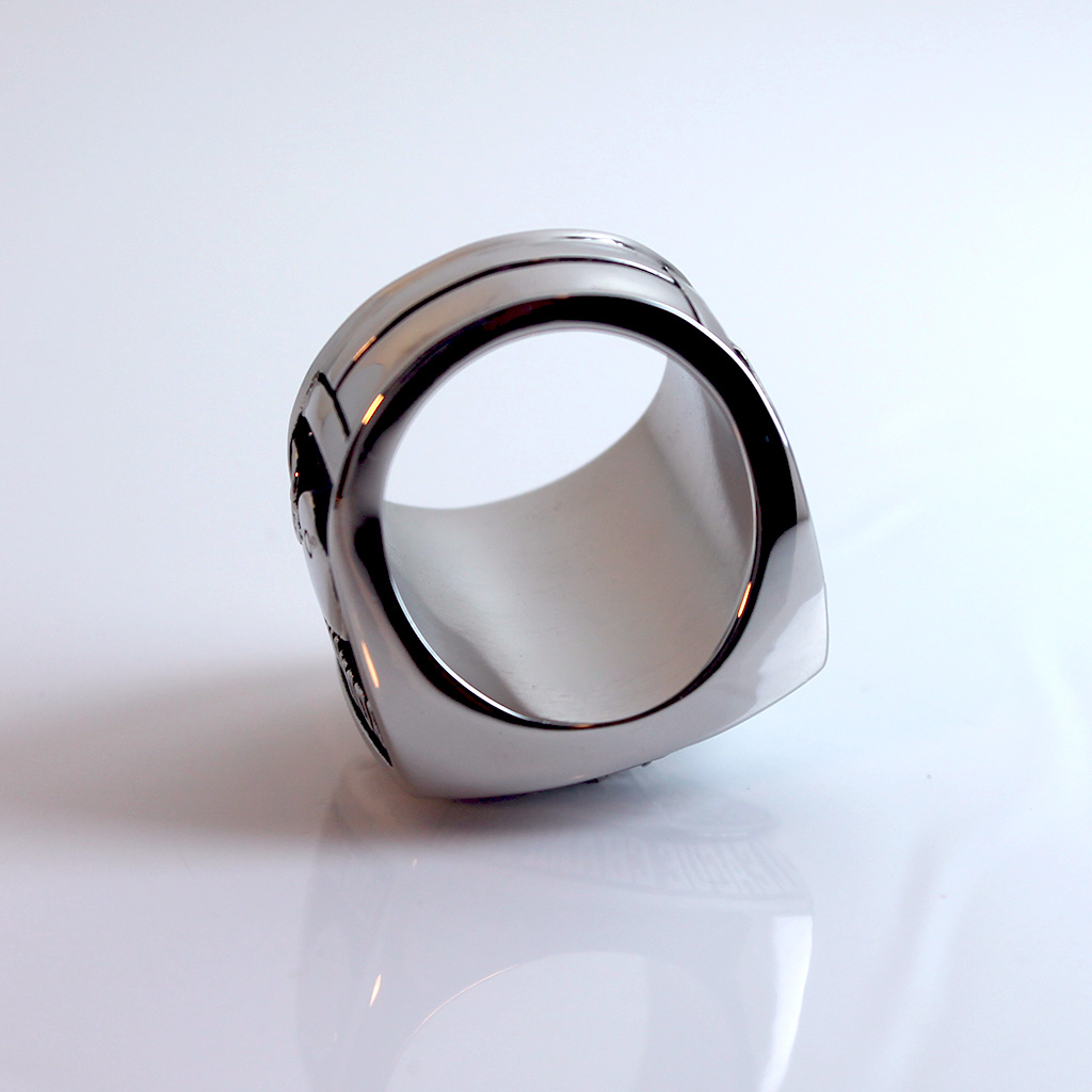 The inside of the ring is a smooth and solid for a hefty and comfortable fit.