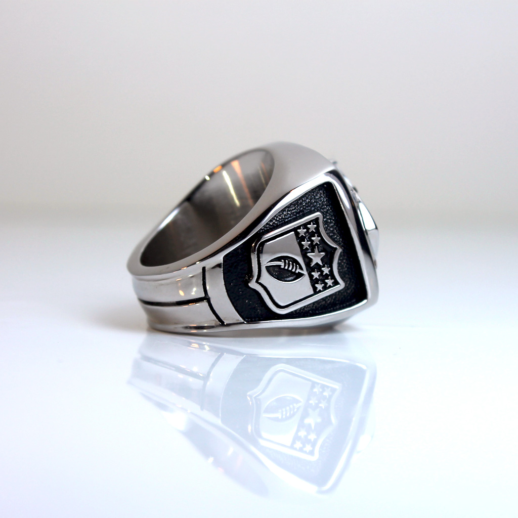 The left side of the championship ring features a logo, that salutes one you might already know and love.